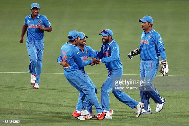 Indian players celebrate after getting the wicket of Ahmad Shahzad of Pakistan during the 2015 ICC Cricket World Cup match between India and Pakistan...