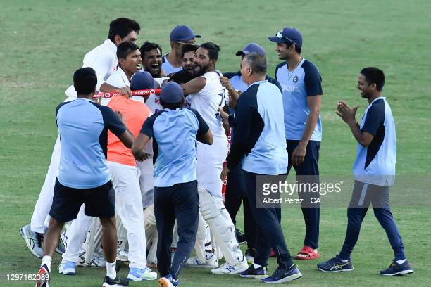 Indian players celebrate after their victory during day five of the 4th Test Match in the series between Australia and India at The Gabba on January...