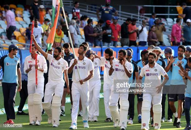 Indian players celebrate at the end of the fourth cricket Test match between Australia and India at The Gabba in Brisbane on January 19, 2021. /...