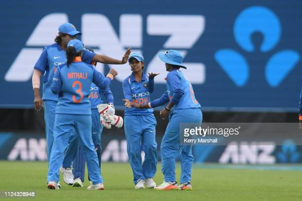 Indian players celebrate bowling New Zealand out during game one of the One Day International Series between New Zealand White Ferns and India at...