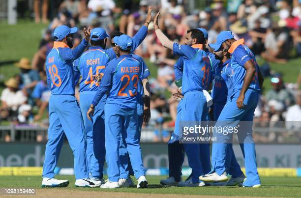 Indian players celebrate during game one of the One Day International series between New Zealand and India at McLean Park on January 23 2019 in...