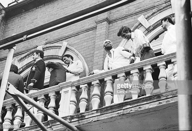 Indian players celebrate on a balcony at the Oval, London, 25th August 1971, after India won the Third Test against England by four wickets to win...