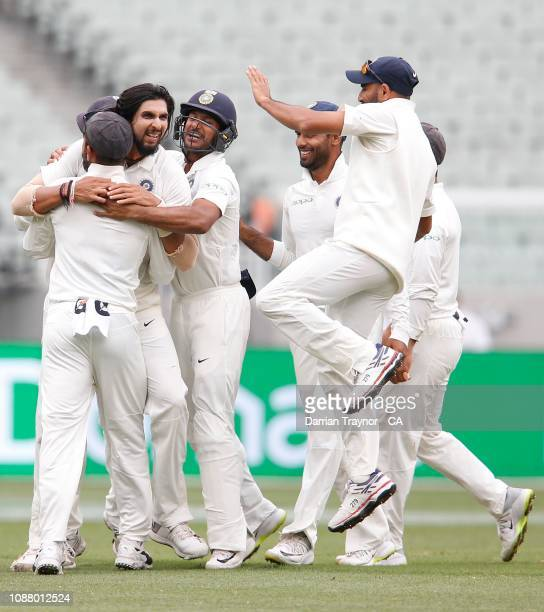 Indian players celebrate the last wicket as they defeat Australia on day five of the Third Test match in the series between Australia and India at...