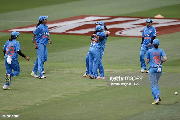 Indian players celebrate the run out of Ellyse Perry of Australia during the women's Twenty20 International match between Australia and India at...