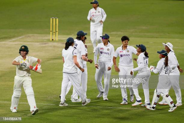 Indian players celebrate the wicket of Beth Mooney of Australia during day four of the Women's International Test Match between Australia and India...