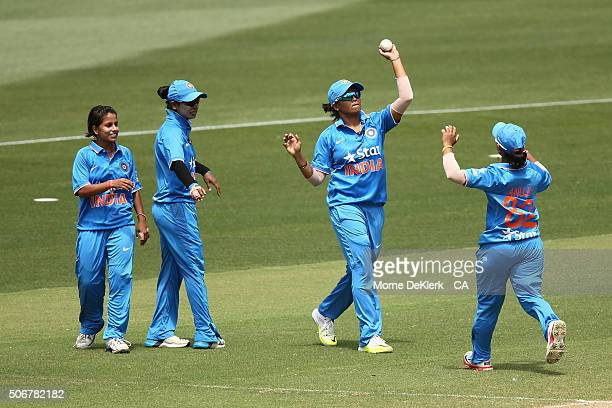 Indian players celebrate the wicket of Ellyse Perry of Australia during the women's Twenty20 International match between Australia and India at...