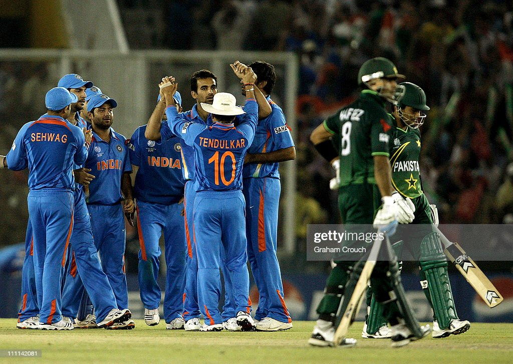 Indian players celebrate the wicket of Kamran Akmal of Pakistan caught by Yuvraj Singh from the bowling of Zaheer Khan during the 2011 ICC World Cup..