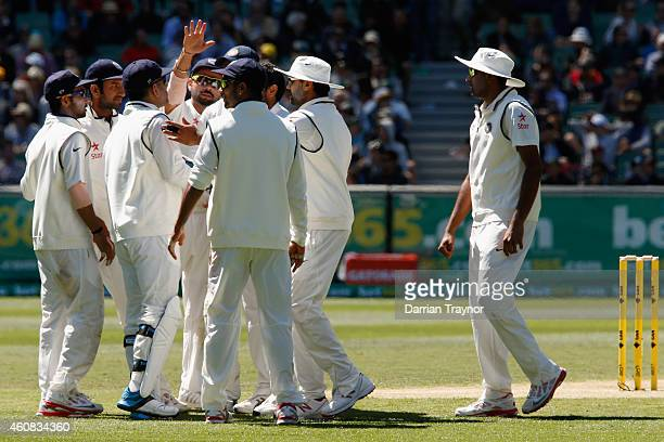 Indian players celebrate the wicket of Shaun Marsh of Australia during day one of the Third Test match between Australia and India at Melbourne...
