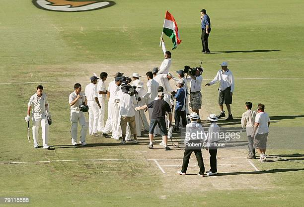 Indian players celebrate their team's 72 run win over Australia after day four of the Third Test match between Australia and India at the WACA on...