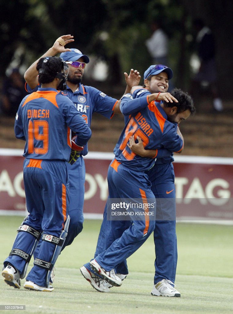 Indian players celebrates the wicket of Zimbabwean batsman Hamilton Masakadza who was bowled out by Indian bowler Amit Mishra in the first match of the Micromax Cup Triangular One-Day International series on May 28, 2010 at Queens Sports club in Bulawayo . AFP PHOTO / Desmond Kwande