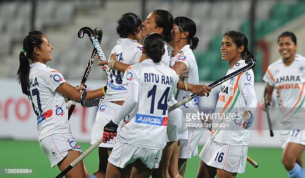 Indian players congratulate Rani Rampal after her goal during their women's field hockey match against Canada of the FIH London 2012 Olympic Hockey...