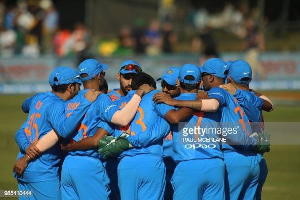 Indian players form a group huddle during the Twenty20 International cricket match between Ireland and India at Malahide cricket club in Dublin on...