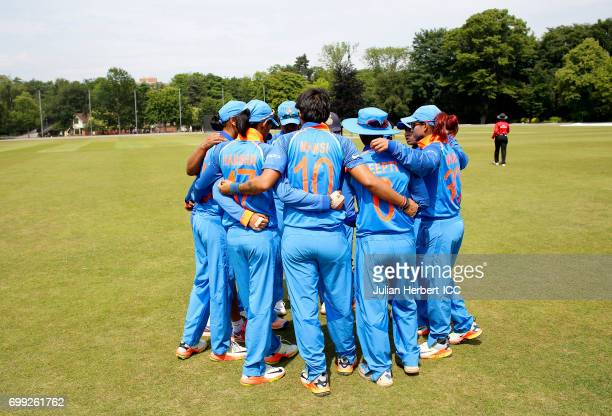 Indian players get in a team huddle as they take to the field during The ICC Women's World Cup warm up match between India and Sri Lanka at Queens...