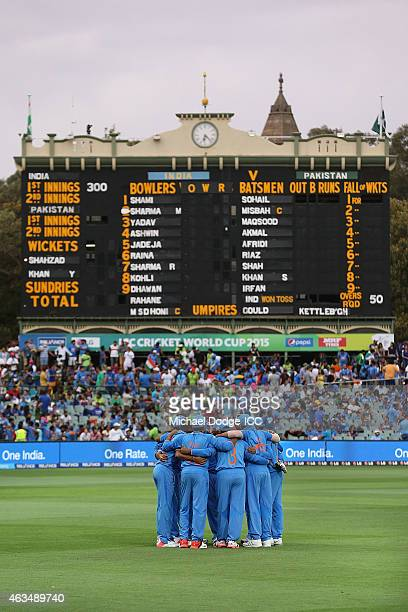 Indian players hudde before they bowl during the 2015 ICC Cricket World Cup match between India and Pakistan at Adelaide Oval on February 15 2015 in...