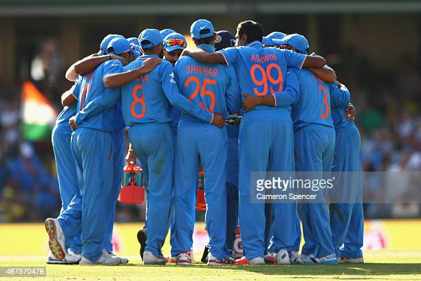 Indian players huddle after taking the wicket of Glenn Maxwell of Australia during the 2015 Cricket World Cup Semi Final match between Australia and...
