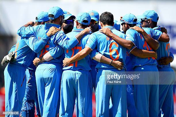 Indian players huddle before taking to the field during the 2015 ICC Cricket World Cup match between India and the United Arab Emirates at WACA on...