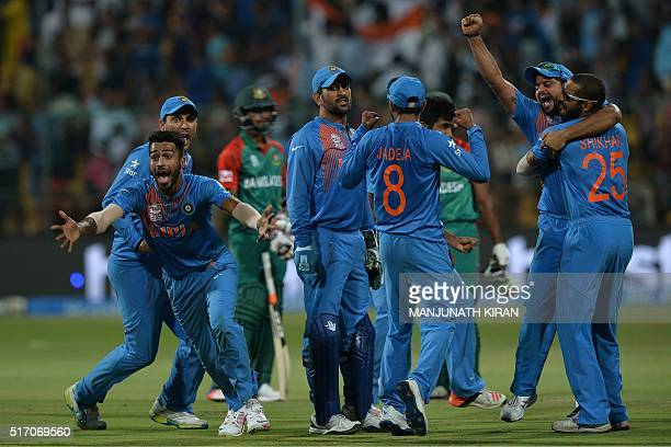 Indian players including Hardik Pandyaand captain Mahendra Singh Dhonicelebrate the wicket that led to the victory of India by 2 runs during the...
