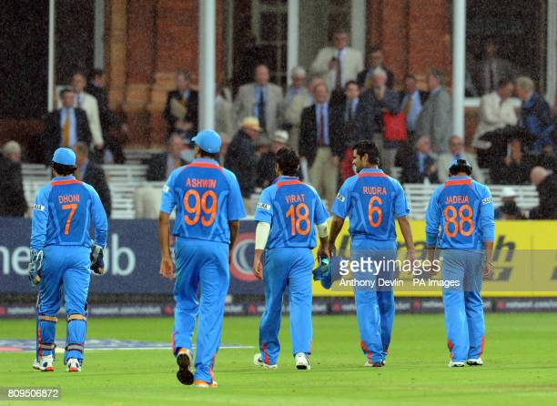 Indian players leave the field as rain stops play during the One Day International between England and India at Lord's cricket ground, London
