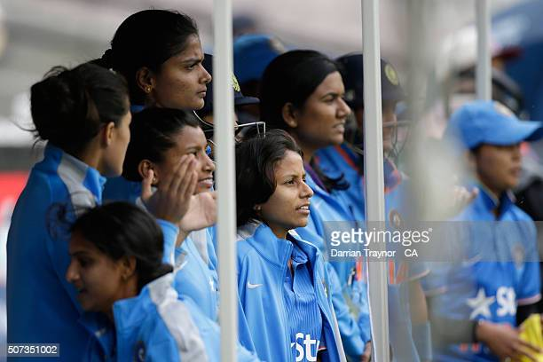 Indian players look on during the women's Twenty20 International match between Australia and India at Melbourne Cricket Ground on January 29 2016 in...