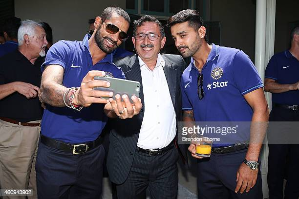 Indian players pose for a 'selfie' during the Australian and Indian cricket team visit at Kirribilli House on January 1 2015 in Sydney Australia