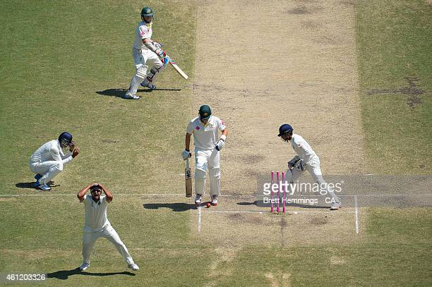 Indian players react after a missed opportunity to run out Shane Watson of Australia during day four of the Fourth Test match between Australia and...