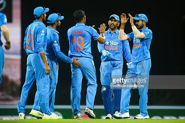 Indian player's rush to congratulate Umesh Yadav after he claimed the wicket of Australia's captain Steven Smith during the oneday international...