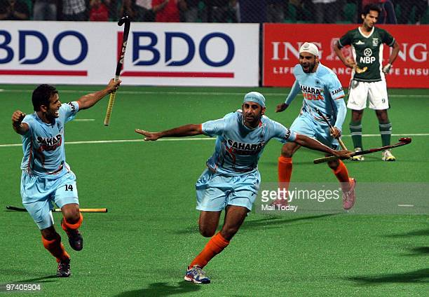 Indian players Sandeep Singh Deepak Thakur and Prabjot Singh celebrate the victory against Pakistan at the Hockey World Cup in New Delhi on February...