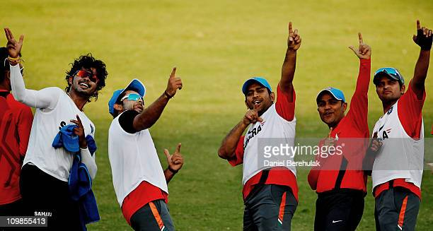 Indian players Shantakumaran Sreesanth Virat Kohli captain MS Dhoni Virender Sehwag and Suresh Raina celebrate after winning a friendly warm up...