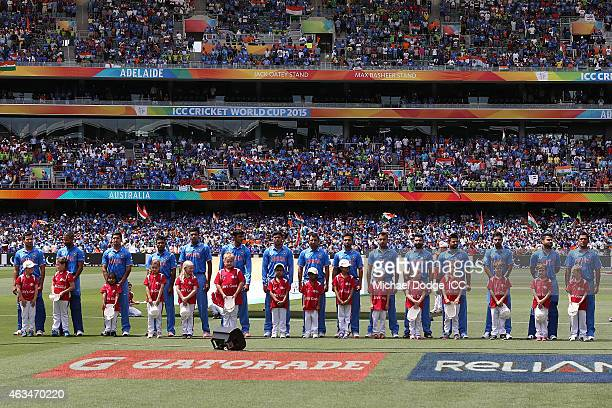 Indian players stand for the national anthem during the 2015 ICC Cricket World Cup match between India and Pakistan at Adelaide Oval on February 15...