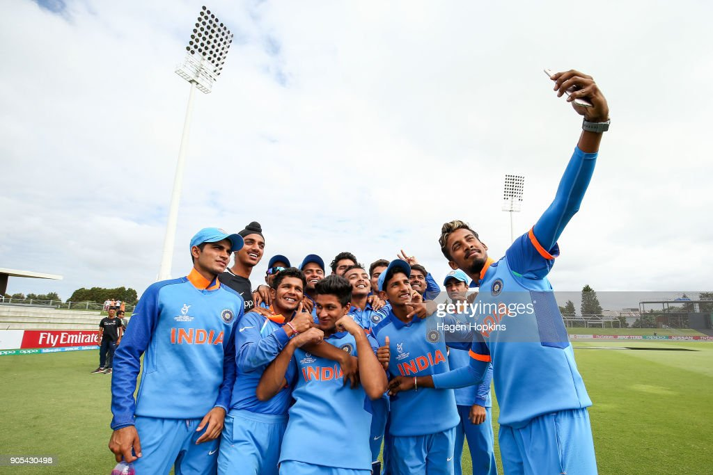 Indian players take a team selfie after winning the ICC U19 Cricket World Cup match between India and Papua New Guinea at Bay Oval on January 16, 2018 in Tauranga, New Zealand.