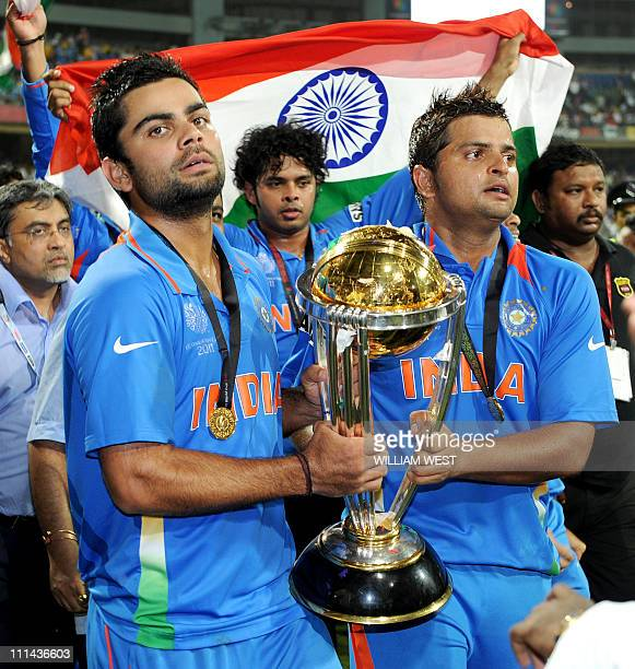 Indian players Virat Kohli and Suresh Raina carry the trophy after India defeated Sri Lanka in the ICC Cricket World Cup 2011 final played at The...