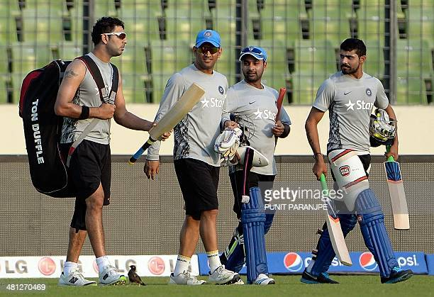 Indian players Yuvraj Singh captain Mahendra Singh Dhoni Amit Mishra and Ravindra Jadeja walk back from the nets during the training session at The...