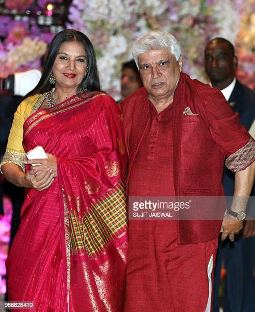 Indian poet lyricist and screenwriter Javed Akhtar and wife and actress Shabana Azmi pose for a picture as they attend the preengagement party of...