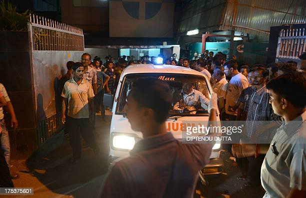 Indian police and hospital staff make way for an ambulance transporting the body of Mangal Singh Rajput a Gorkha People's Liberation Front supporter...