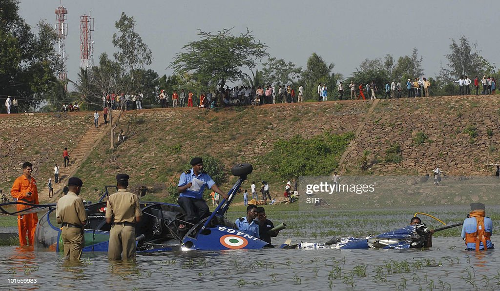 Indian police and Navy personnel gather at the site of a crashed Indian Navy Chetak helicopter in Ankapalle, some 700 kilometers from Hyderabad, on June 2, 2010. The Chetak helicopter, deployed at INS Dega, crashed into a stream at Ankapalle, about 50 kms from Visakhapatnam, which is the headquarters of Eastern Naval Command, a Navy spokerperson said. One person was killed and three others injured in the crash.