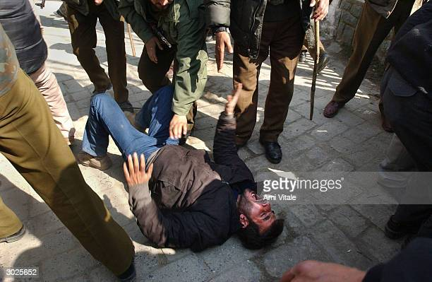 Indian police arrest and beat Kashmiri Shiite Muslims as they tried to celebrate the Muharram February 29 2004 in Srinagar India Shiite Muslims...