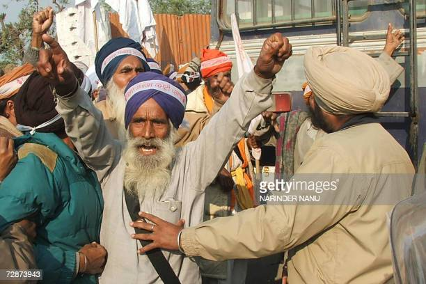 Indian police baton charge Indian farmers during an anti-government rally at which the farmers attempted to block the Amritsar to Ganga Nagar...