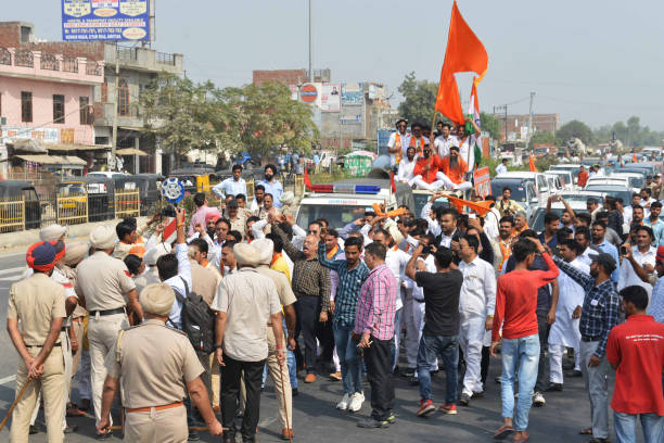 Indian police block activists of Shiv Sena as they march towards the IndiaPakistan Wagah border during a protest march against the killing of Indian..