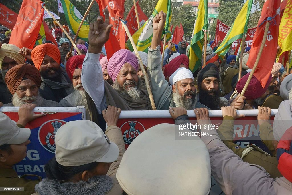 TOPSHOT Indian police block farmers as they march towards the residence of Cabinet Minister Bikram Singh Majithia during a protest in Amritsar on...