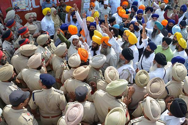 Indian police block Sikh activists as they protest against the state government in Amritsar on November 1 2015 Activists have rallied against the...