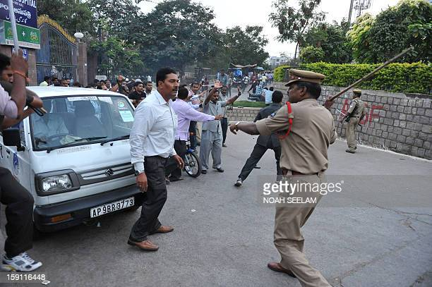Indian police charge supporters of the MajliseIttehadul Muslimeen party after the arrest of their leader Akbaruddin Owaisi in Hyderabad on January 8...