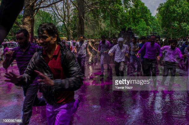 Indian police chase away Kashmiri government teachers during a protest against the government on July 17 2018 in Srinagar the summer capital of...