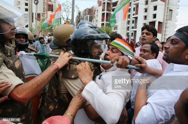 Indian police clash with Congress Party workers as they take part in a demonstration calling for the resignation of the chief minister of the state...