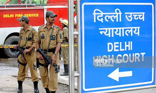 Indian police commandos stand guard in front of Delhi High Court in New Delhi on September 8 2011 A powerful bomb ripped through a packed reception...