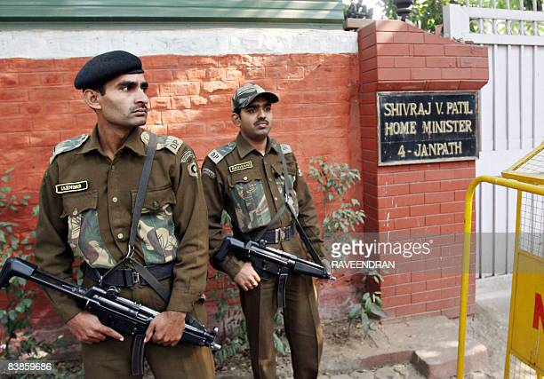 Indian police commandos stand guard in front of Home Minister Shivraj Patil's residence in New Delhi on November 30 2008 Indian Home Minister Shivraj...