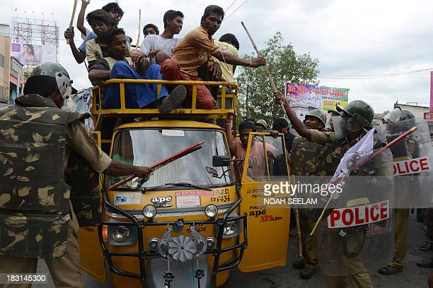Indian police confront supporters of united Andhra Pradesh during a protest against the formation of Telangana state in Kurnool district some 200 kms...