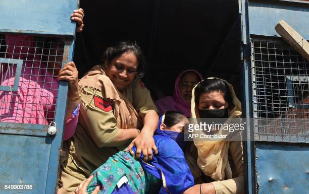 Indian police detain a Kashmiri 'Anganwadi' a government sponsored child and mother care worker during a hunger strike to protest against the state...