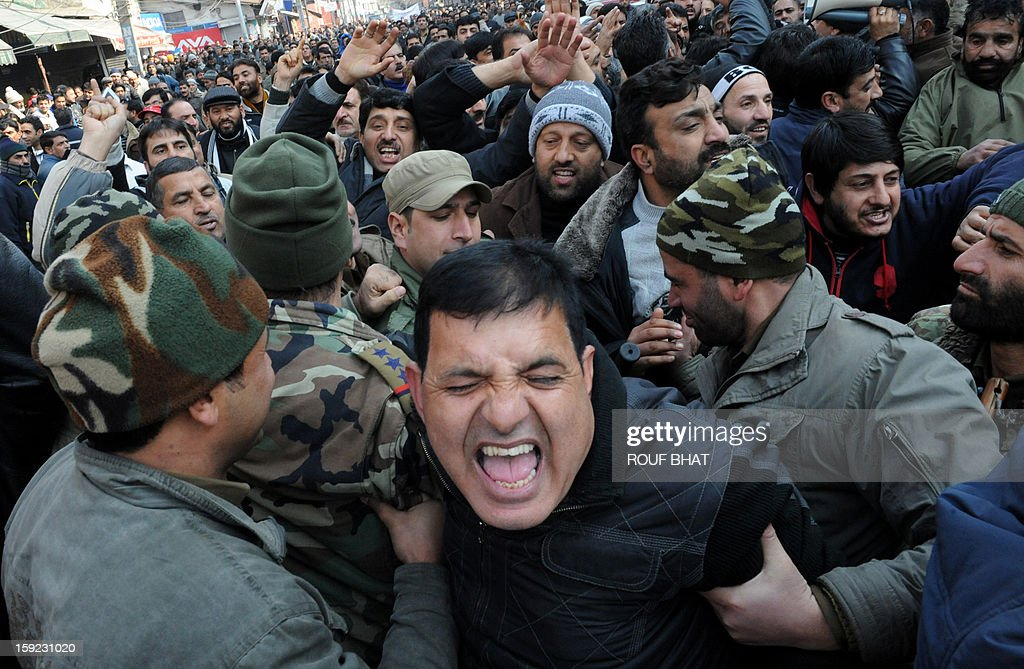 Indian police detain a Kashmiri state government employee during a protest march in Srinagar on January 10, 2013. Dozens of government employees were arrested as they tried to stage a protest march in Srinagar. Local government employees began a three-day strike January 8 to build pressure on the region's government to take decision on their pending demands which include improvements on contractors wages and retirement benefits. AFP PHOTO/Rouf BHAT