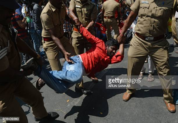 TOPSHOT Indian police detain a member of the Revolutionary Students Youth Federation during a protest against the razing down of a statue of...