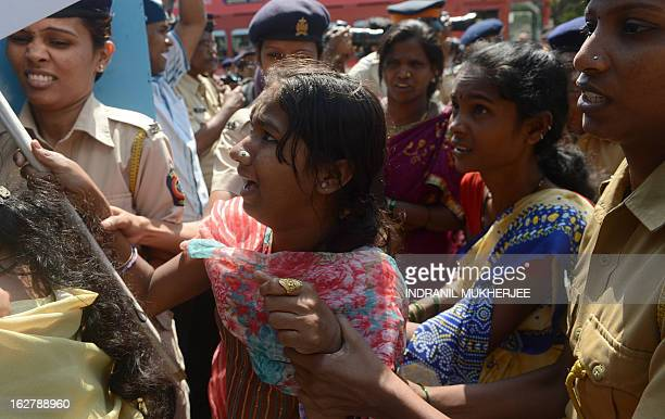 Indian police detain activists of the Republic Party of India protesting against the rape and killing of three young sisters earlier in the month in...